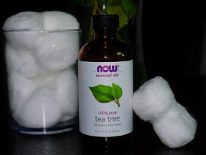 NOW Pure Tea Tree Essential Oil applied with cotton balls